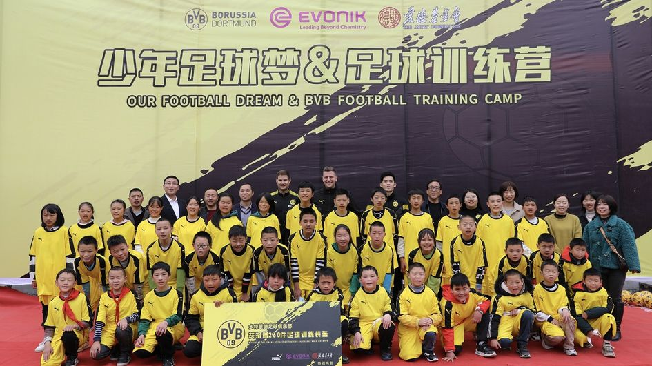 """Evonik teams up with Borussia Dortmund (BVB) Football Club and the Amity Foundation on the """"Youth Football Dream"""" charity project."""